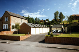 A stepped block of Heritage garages compliments these new-build houses